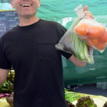 Showing off his produce - a happy market shopper
